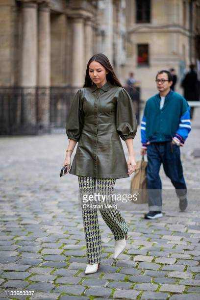 A guest is seen wearing olive jacket outside Thom Browne during Paris Fashion Week Womenswear Fall/Winter 2019/2020 on March 03 2019 in Paris France