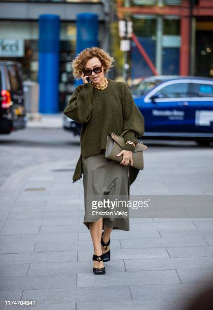 A guest is seen wearing olive knit skirt bag outside Ports 1961 during London Fashion Week September 2019 on September 14 2019 in London England