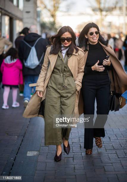 A guest is seen wearing olive overall outside Roland Mouret during London Fashion Week February 2019 on February 17 2019 in London England