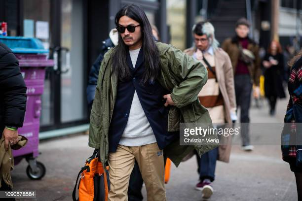 Guest is seen wearing olive parka during London Fashion Week Men's January 2019 on January 06, 2019 in London, England.