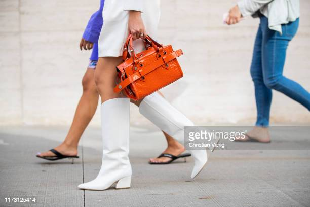 Guest is seen wearing orange bag outside Longchamp during New York Fashion Week September 2019 on September 07, 2019 in New York City.