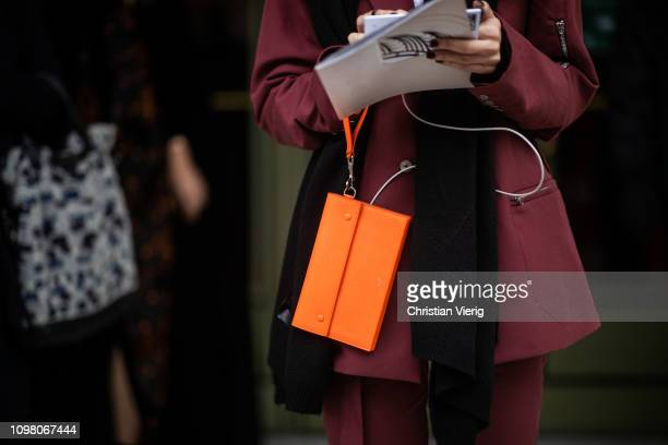 A guest is seen wearing orange Celine bag outside Stephane Rolland during Haute Couture Spring Summer 2019 Day Two on January 22 2019 in Paris France