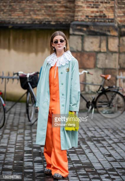 Guest is seen wearing orange overall, yellow bag, coat outside Blanche on Day 1 during Copenhagen Fashion Week Autumn/Winter 2020 on January 28, 2020...