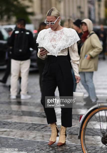 Guest is seen wearing outside the Chanel show during Paris Fashion Week SS20 on October 1, 2019 in Paris, France.