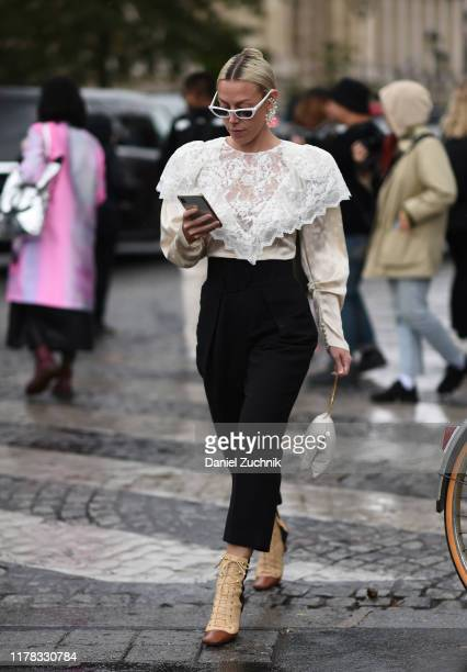A guest is seen wearing outside the Chanel show during Paris Fashion Week SS20 on October 1 2019 in Paris France