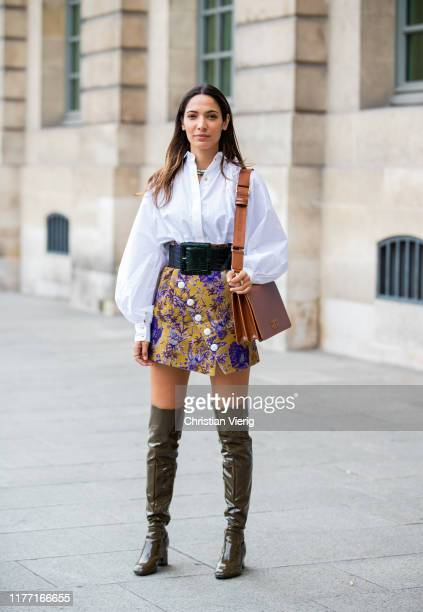 Guest is seen wearing overknees boots, white button shirt, shorts with print, brown bag outside Guy Laroche during Paris Fashion Week Womenswear...