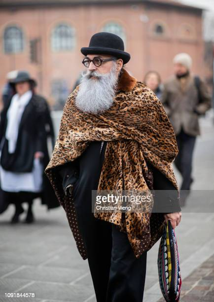 A guest is seen wearing oversized scarf with animal print during the 95th Pitti Uomo at Fortezza Da Basso on January 09 2019 in Florence Italy