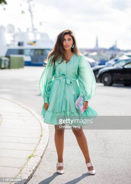 Guest is seen wearing pastel dress outside Stine Goya during Copenhagen Fashion Week Spring/Summer 2020 on August 08, 2019 in Copenhagen, Denmark.