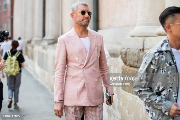Guest is seen wearing pastel suit outside M1992 during the Milan Men's Fashion Week Spring/Summer 2020 on June 15, 2019 in Milan, Italy.
