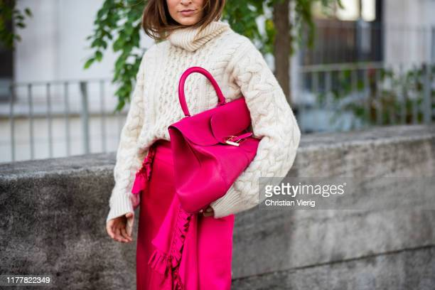 Guest is seen wearing pink bag, wrapped skirt outside Haider Ackermann during Paris Fashion Week Womenswear Spring Summer 2020 on September 28, 2019...