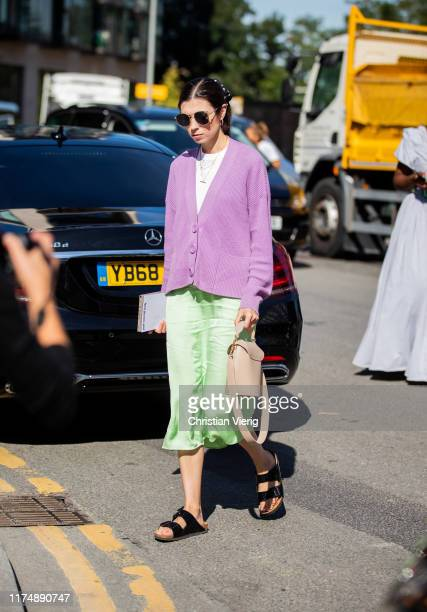 A guest is seen wearing pink cardigan outside Preen during London Fashion Week September 2019 on September 15 2019 in London England