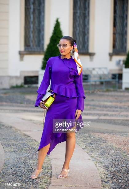 Guest is seen wearing pink dre outside the Tod's show during Milan Fashion Week Spring/Summer 2020 on September 20, 2019 in Milan, Italy.