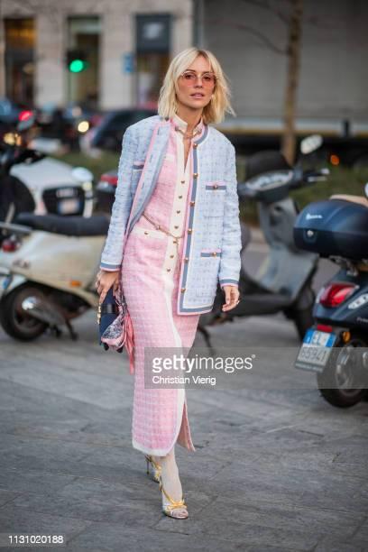 A guest is seen wearing pink dress blue jacket Gucci bag outside Alberta Ferretti on Day 1 Milan Fashion Week Autumn/Winter 2019/20 on February 20...