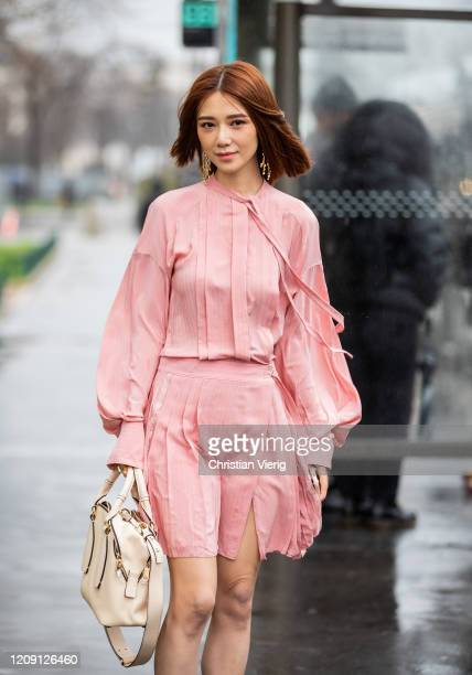 Guest is seen wearing pink dress outside Chloe during Paris Fashion Week - Womenswear Fall/Winter 2020/2021 : Day Four on February 27, 2020 in Paris,...