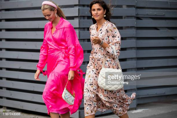 Guest is seen wearing pink dress, sneaker, Louis Vuitton bag and a guest wearing dress with floral print, white Chanel bag outside Munthe during...