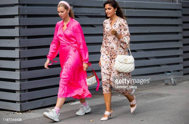 A guest is seen wearing pink dress sneaker Louis Vuitton bag outside Munthe during Copenhagen Fashion Week Spring/Summer 2020 on August 07 2019 in...