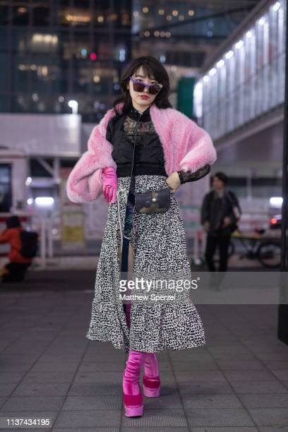 A guest is seen wearing pink fur coat black sheer top spotted skirt pink thigh high velvet heels during the Amazon Fashion Week TOKYO 2019 A/W on...