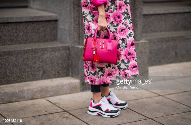 A guest is seen wearing pink Gucci bag and coat with floral print during MercedesBenz Tbilisi Fashion Week on November 2 2018 in Tbilisi Georgia