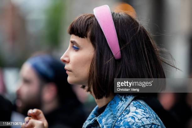 Guest is seen wearing pink hair hoop outside John Lawrence Sullivan during London Fashion Week Men's June 2019 on June 08, 2019 in London, England.