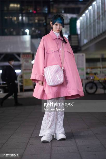 A guest is seen wearing pink oversized jacket white pants and sneakers white bag during the Amazon Fashion Week TOKYO 2019 A/W on March 21 2019 in...