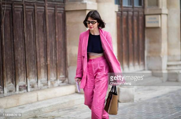 Guest is seen wearing pink pants and blazer outside Thom Browne during Paris Fashion Week Womenswear Fall/Winter 2019/2020 on March 03, 2019 in...