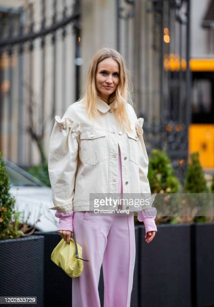 Guest is seen wearing pink pants, creme white jacket with ripped sleeves outside Custommade during Copenhagen Fashion Week Autumn/Winter 2020 Day 2...