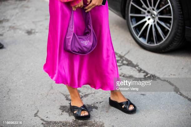 Guest is seen wearing pink Prada bag outside By Malene Birger during Copenhagen Fashion Week Spring/Summer 2020 on August 08, 2019 in Copenhagen,...