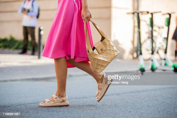 A guest is seen wearing pink ripped dress beige Chanel bag sandals outside Helmstedt during Copenhagen Fashion Week Spring/Summer 2020 on August 07...