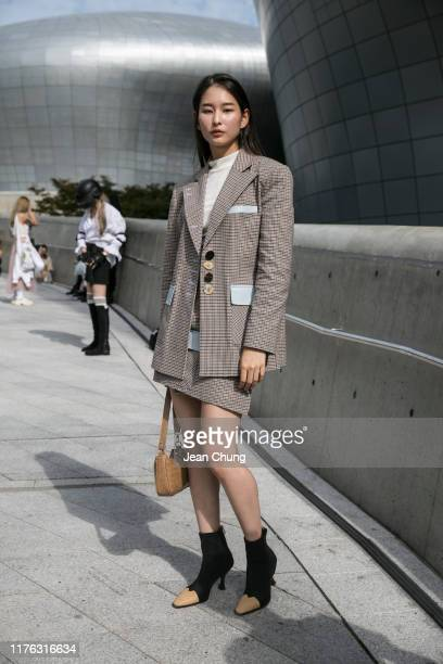 Guest is seen wearing plaid blazer and skirt during the Seoul Fashion Week 2020 S/S at Dongdaemun Design Plaza on October 17, 2019 in Seoul, South...