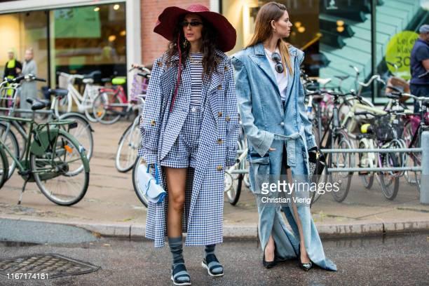 A guest is seen wearing plaid coat floppy hat outside Saks Potts during Copenhagen Fashion Week Spring/Summer 2020 on August 08 2019 in Copenhagen...