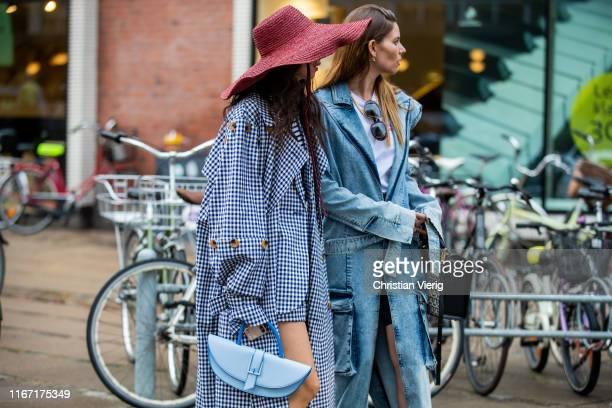 Guest is seen wearing plaid coat, floppy hat outside Saks Potts during Copenhagen Fashion Week Spring/Summer 2020 on August 08, 2019 in Copenhagen,...