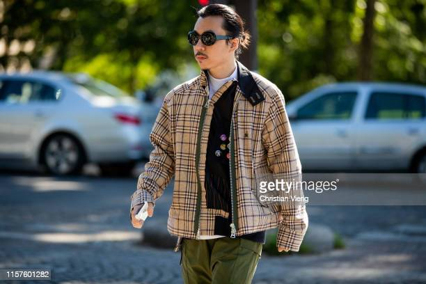 Guest is seen wearing plaid jacket outside Sacai during Paris Fashion Week - Menswear Spring/Summer 2020 on June 22, 2019 in Paris, France.