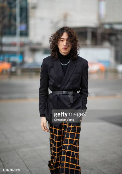 A guest is seen wearing plaid pants black blazer with belt at the Hera Seoul Fashion Week 2019 F/W at Dongdaemun Design Plaza at Dongdaemun Design...