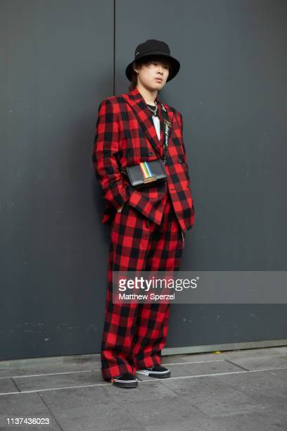 A guest is seen wearing plaid red suit bucket hat during the Amazon Fashion Week TOKYO 2019 A/W on March 21 2019 in Tokyo Japan