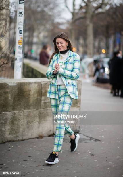 Guest is seen wearing plaid suit outside Acne during Paris Fashion Week - Menswear F/W 2019-2020 Day Six on January 20, 2019 in Paris, France.