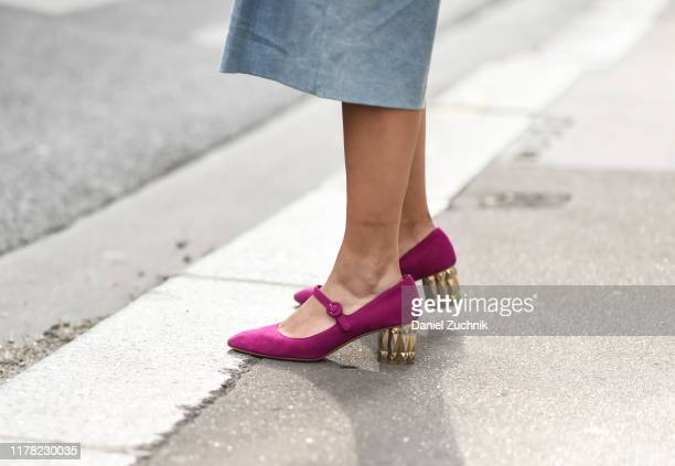 A guest is seen wearing purple and gold heels outside the APC show during Paris Fashion Week SS20 on September 30 2019 in Paris France