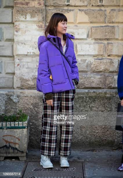 A guest is seen wearing purple jacket plaid pants outside Marni during Milan Menswear Fashion Week Autumn/Winter 2019/20 on January 12 2019 in Milan...