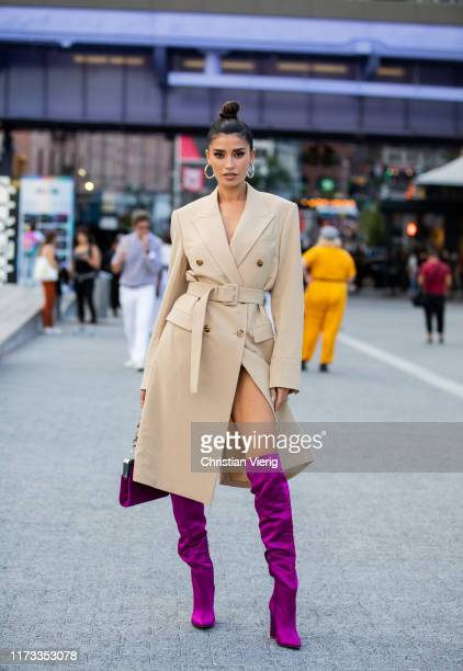A guest is seen wearing purple overknees boots beige coat outside Jason Wu during New York Fashion Week September 2019 on September 08 2019 in New...