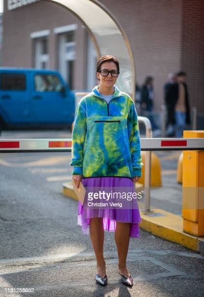 A guest is seen wearing purple skirt jacket with print outside Fendi on Day 2 Milan Fashion Week Autumn/Winter 2019/20 on February 21 2019 in Milan...