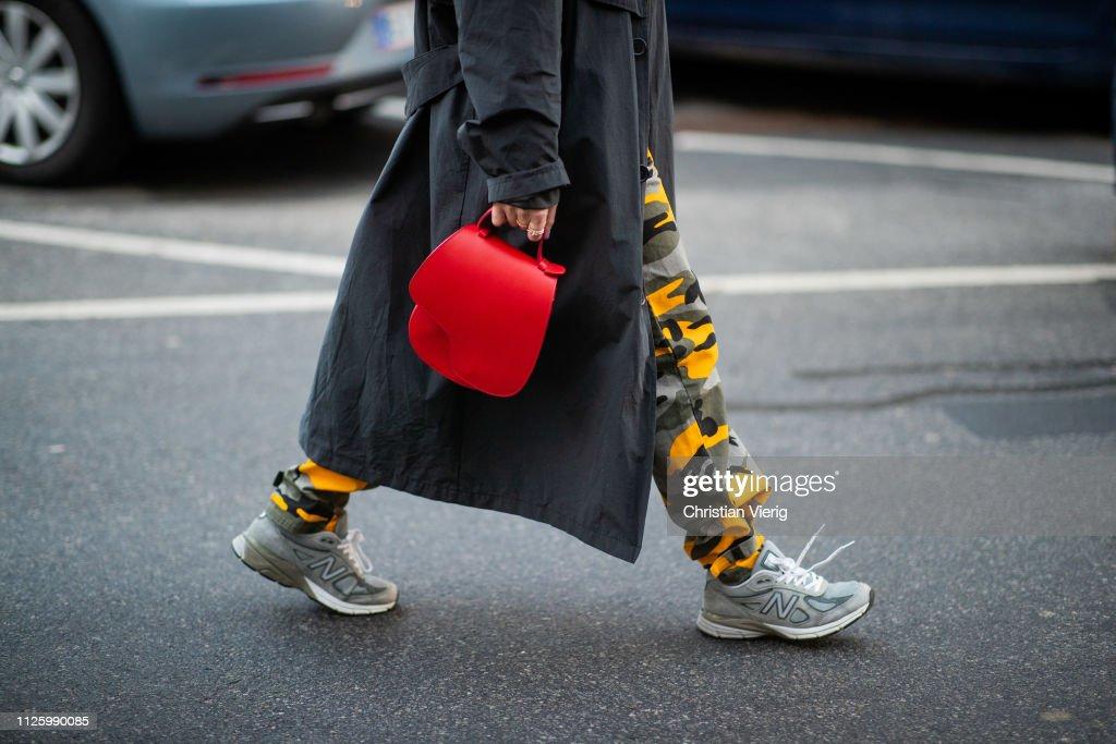 erilaisia muotoiluja paras paikka tehdasmyymälät A guest is seen wearing red bag, New Balance sneakers, pants ...
