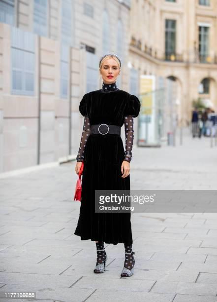 Guest is seen wearing red bag, sheer socks, velvet dress outside Guy Laroche during Paris Fashion Week Womenswear Spring Summer 2020 on September 25,...