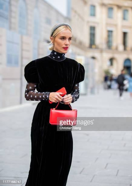 A guest is seen wearing red bag sheer socks velvet dress outside Guy Laroche during Paris Fashion Week Womenswear Spring Summer 2020 on September 25...