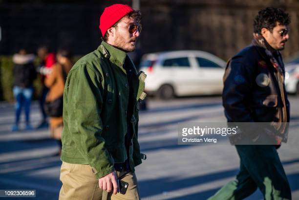 A guest is seen wearing red beanie during the 95th Pitti Uomo at Fortezza Da Basso on January 10 2019 in Florence Italy
