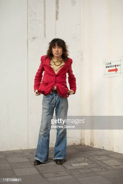 A guest is seen wearing red blazer yellow shirt blue jeans during the Amazon Fashion Week TOKYO 2019 A/W on March 21 2019 in Tokyo Japan