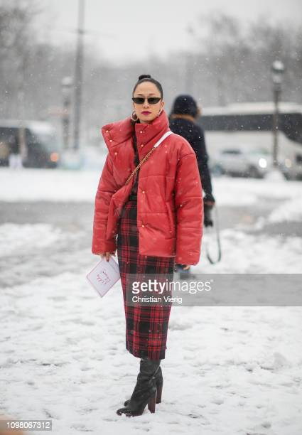 A guest is seen wearing red down feather jacket plaid skirt outside Chanel during Haute Couture Spring Summer 2019 Day Two on January 22 2019 in...