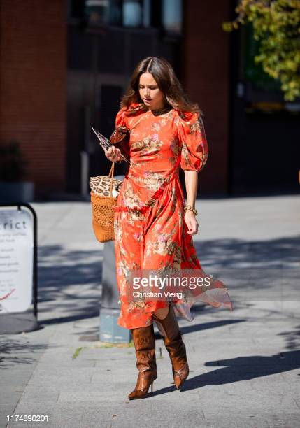 A guest is seen wearing red dress with floral print outside Preen during London Fashion Week September 2019 on September 15 2019 in London England