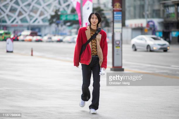 A guest is seen wearing red jacket at the Hera Seoul Fashion Week 2019 F/W at Dongdaemun Design Plaza at Dongdaemun Design Plaza on March 23 2019 in...