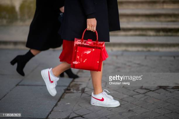 A guest is seen wearing red see through bag outside Louis Vuitton during Paris Fashion Week Womenswear Fall/Winter 2019/2020 on March 05 2019 in...