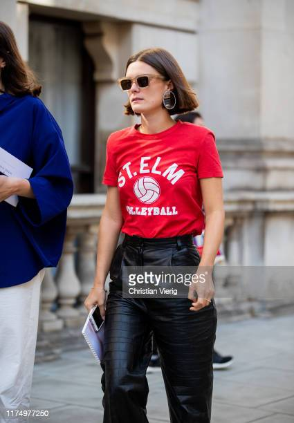 Guest is seen wearing red tshirt outside Victoria Beckham during London Fashion Week September 2019 on September 15, 2019 in London, England.
