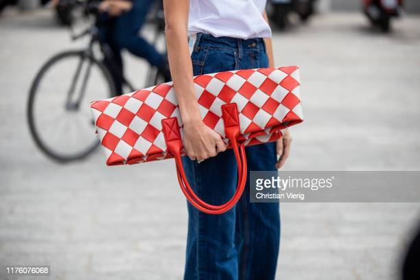 A guest is seen wearing red white checkered bag outside the Sportmax show during Milan Fashion Week Spring/Summer 2020 on September 20 2019 in Milan...